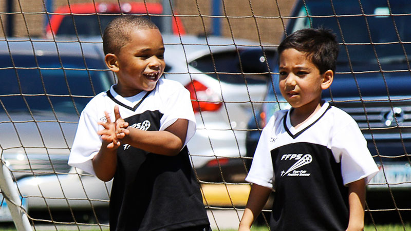 Kids enjoying soccer in the Fun-Fair-Positive Socceer league